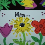 Flower Magnet for Mom... add a rhinestone to the center of the flower sticker.
