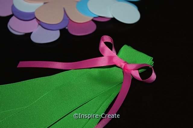 Hanging Flower Bouquet... tie Pink Bow at the top of green ribbon.