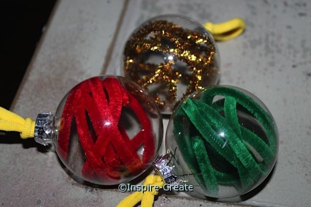 Chenille Stem Ornament Idea! Glass Bulbs & Chenille Stems make these simple & fun to make.