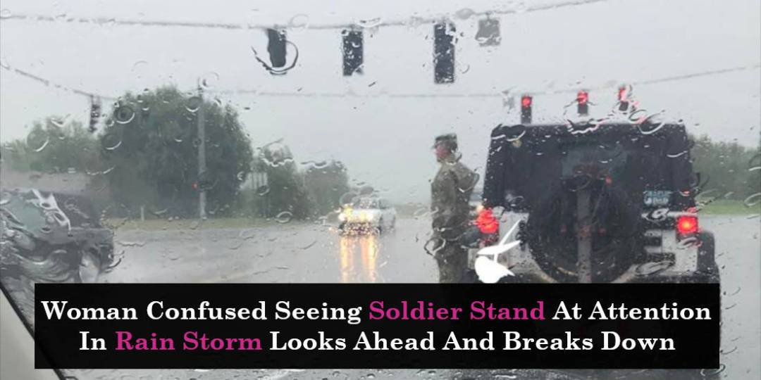 Woman Confused Seeing Soldier Stand At Attention In Rain Storm Looks Ahead And Breaks Down