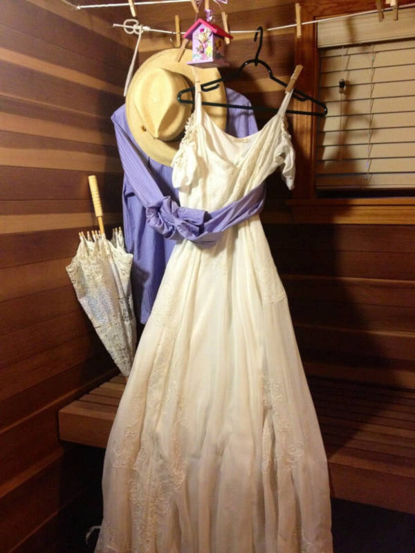 14. This lady has her wedding outfit hung out in an embrace even after her husband passed away.