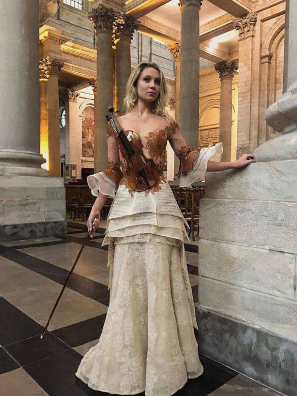 French Designer Creates Unique Dresses From The Spines of Books - 10