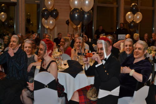 Corporate retirement dinner; all guests had a mask of the retiree hidden under their chairs which they found and wore at a certain moment during the speeches!