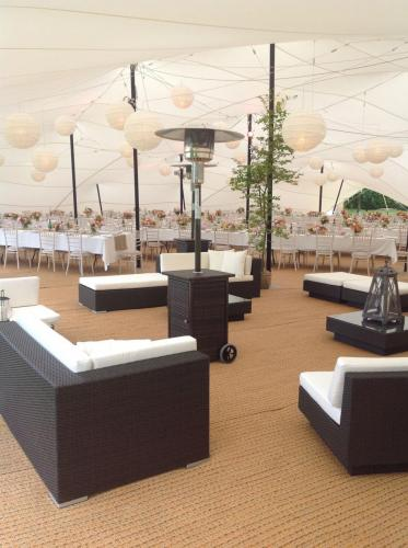 Stretch Tent wedding with rattan chill out furniture and plenty of heaters!