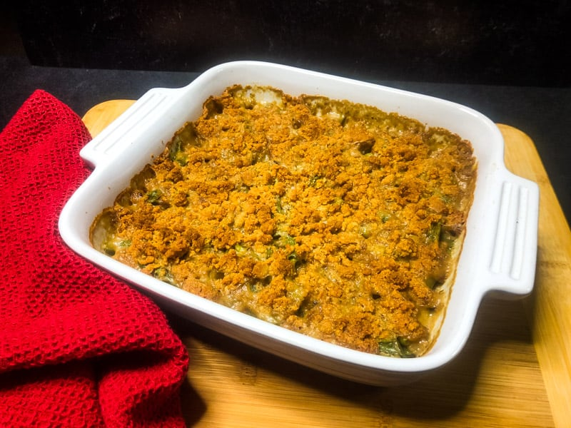 Green Bean Casserole resting on a cutting board after being baked.
