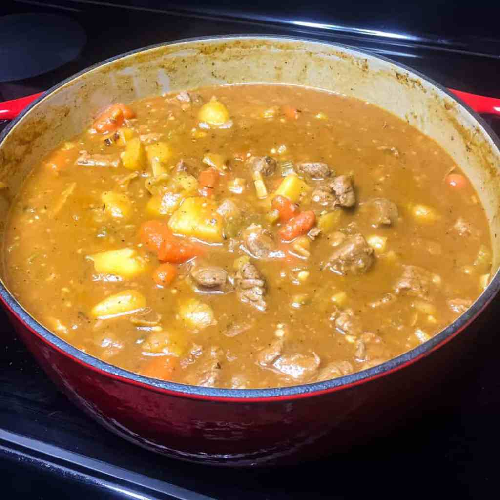Irish Beef Stew simmering and thickening on the stove top.