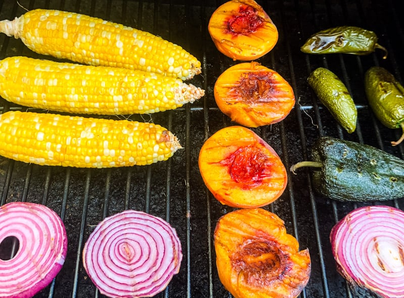 Corn on the cob, peaches, red onion, jalapenos, and pablano pepper on the grill.