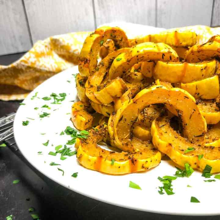Close up of Roasted Delicata Squash on a white plate