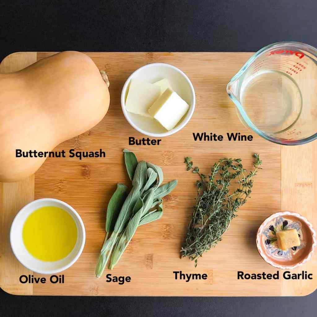 Ingredients for Savory Roasted Butternut Squash on a brown cutting board.