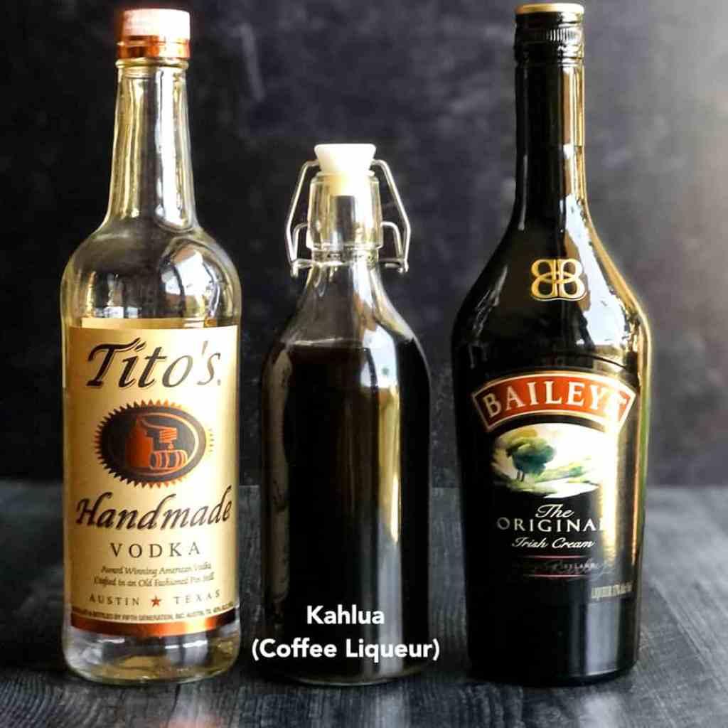 Bottles of Tito's, homemade Kahlua, and Bailey's Irish Cream.