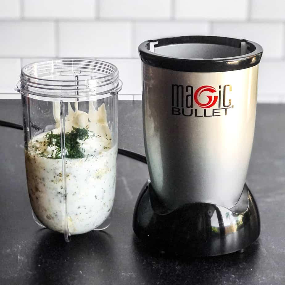 Salad dressing ingredients in the jar of a mini blender.