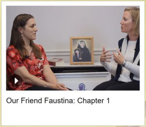 Michele and Emily sitting in front of a picture of St. Faustina