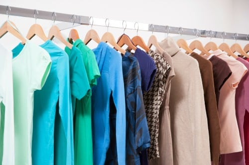 Colored t-shirts hanging on clothing rack - Saving Your Family Money On Clothing