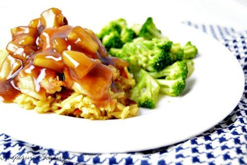 Finished Easy sweet and sour chicken with rice & broccoli on white plate