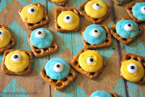 adding candy eyes to minion colored chocolates