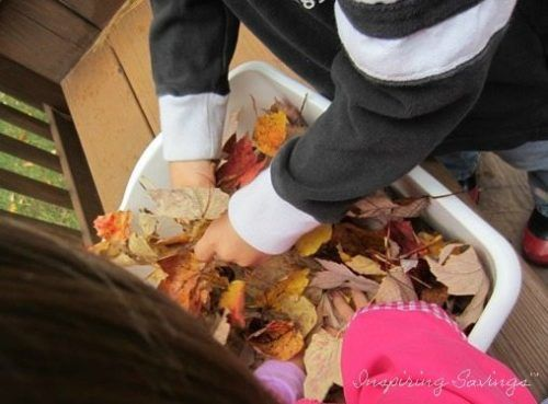 Children crushing leaves with hands