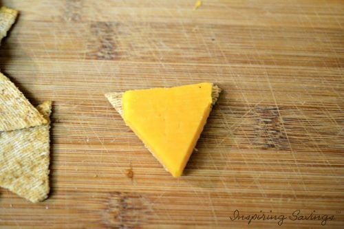 Adding triangle cute cheese to triangle shaped cracker
