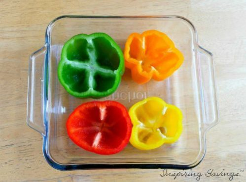 Multi colored peppers cut in glass baking dish - Shephard's pie
