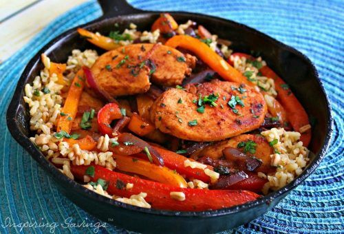 Fajita Style Easy Chicken And Rice in cast iron skillet on blue mat