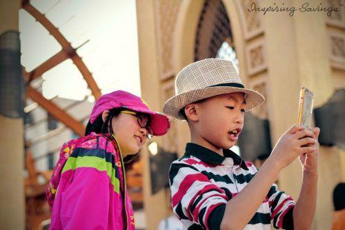 Two children playing pokemon go