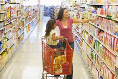 Woman and Child shopping in grocery store