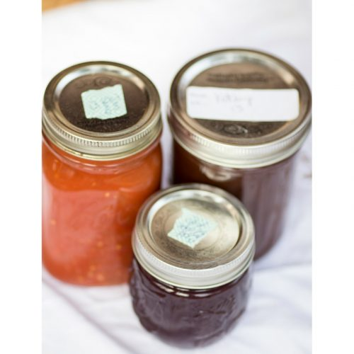 Trio of canning jars on white background