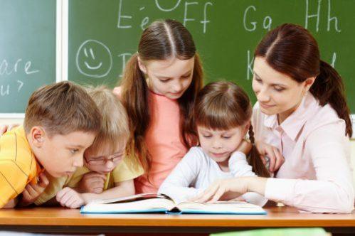 teacher reading book for children