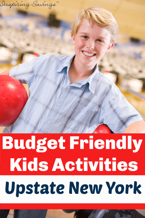 Boy holding red bowling ball. Budget friendly kids activities