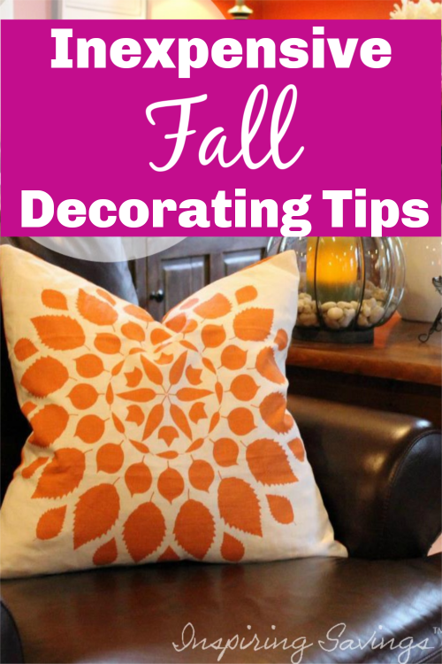 Brown leather chair with decorative orange pillow - Decorating for fall on a budget