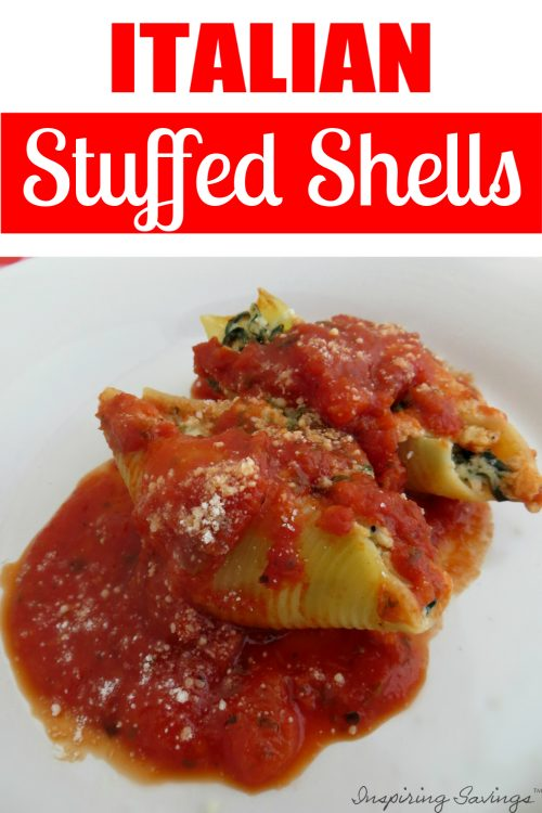 Stuffed italian shells on white plate with red sauce