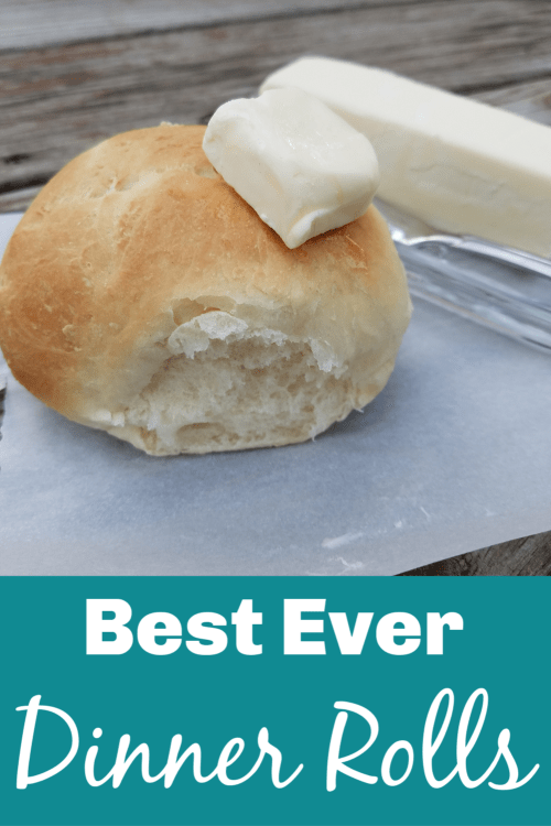Homemade dinner roll with melted butter tab on top