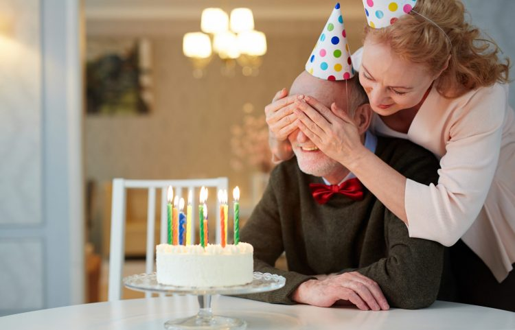 Couple celebrating birthday with a cake