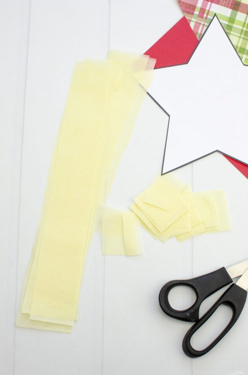 Cutting Yellow Tissue paper into strip for craft project
