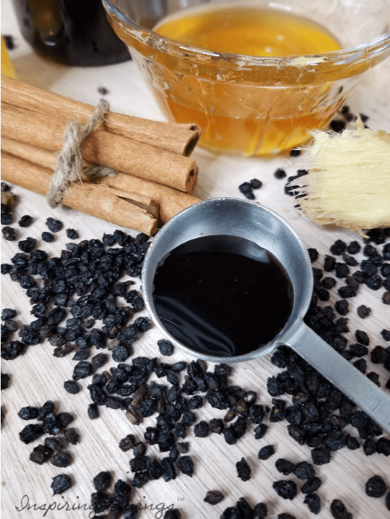 Homemade elderberry syrup in tablespoon