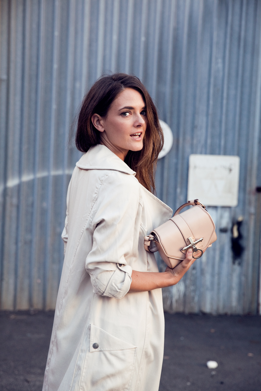 Inspiring Wit blogger Jenelle Witty for Rockingham Shopping Center April Throwback campaign, pictured wearing trench coat and jeans from Cotton On, Nike Free Runners, Givenchy Obsedia Bag