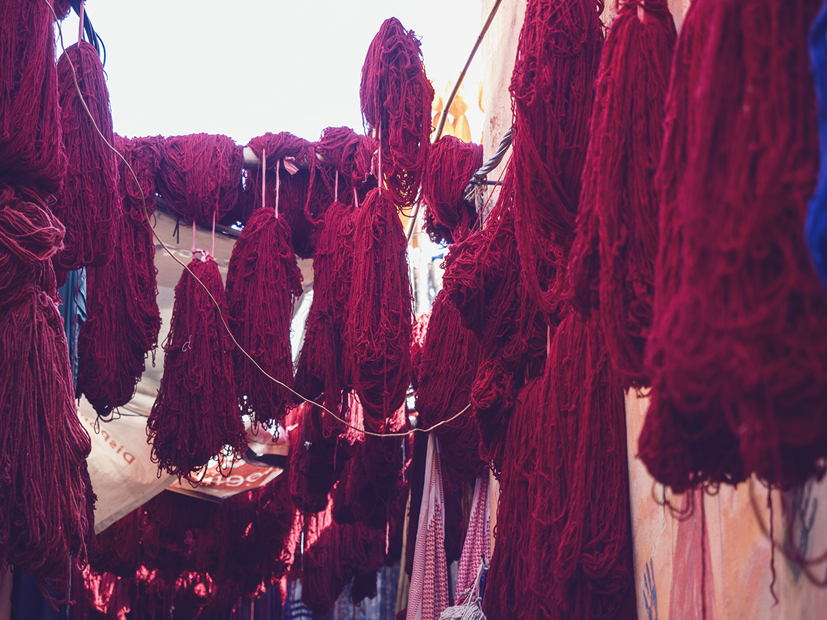 Morocco travel diary Inspiring Wit red dyed wool drying in souks of Marrakech