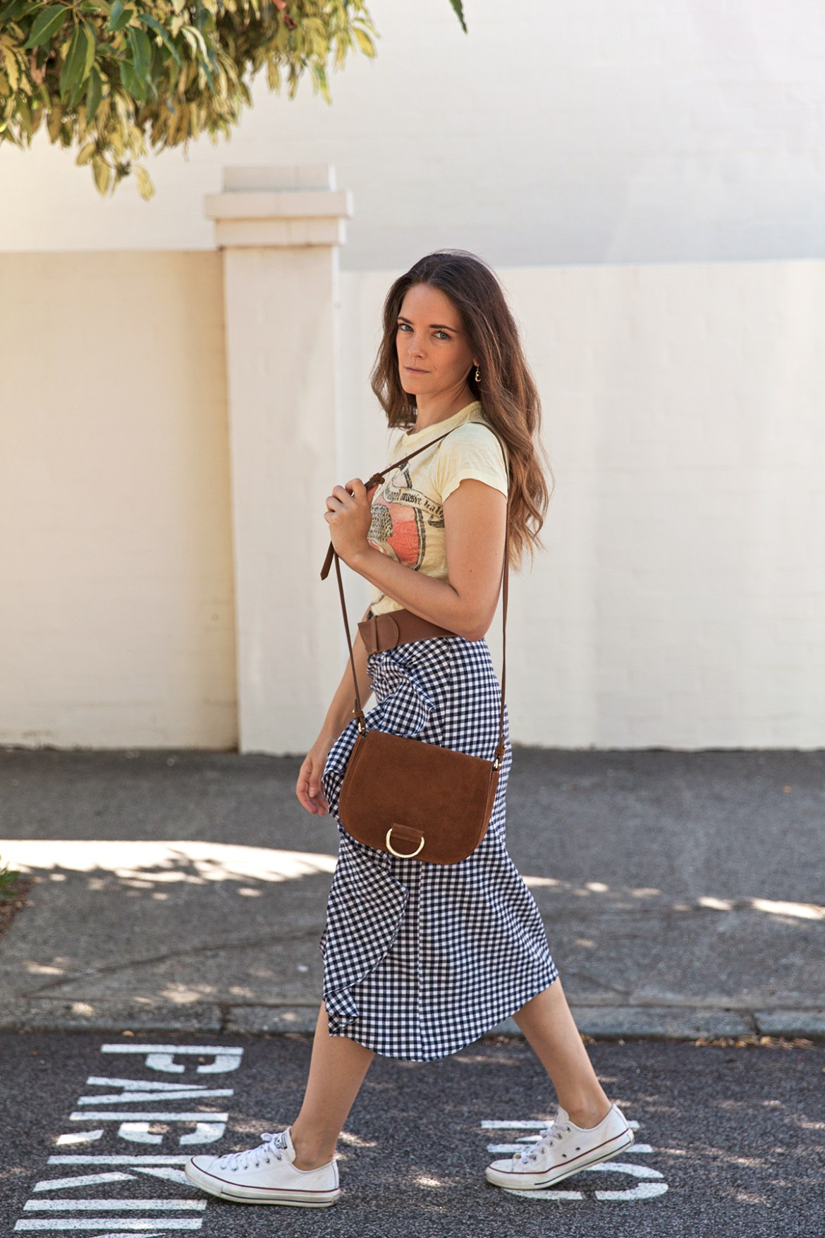 Inspiring Wit fashion blogger from Australia in Topshop gingham ruffle skirt for spring 2017 and suede Little Liffner bag street style