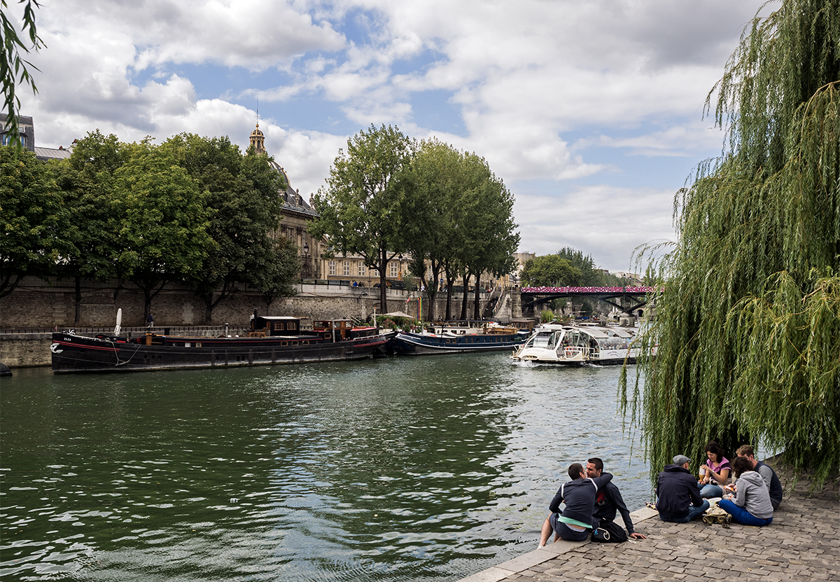 Pont Neuf along the Seine in Paris. Ultimate Parisian city guide by travel blogger Inspiring Wit