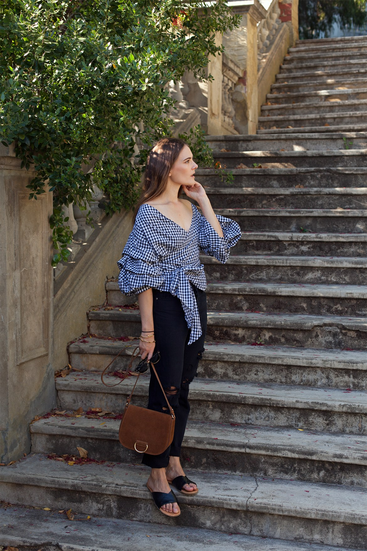 gingham top with ruffle sleeve, Little Liffner saddle bag, and boyfriend jeans, worn by inspiring wit Australian fashion blogger