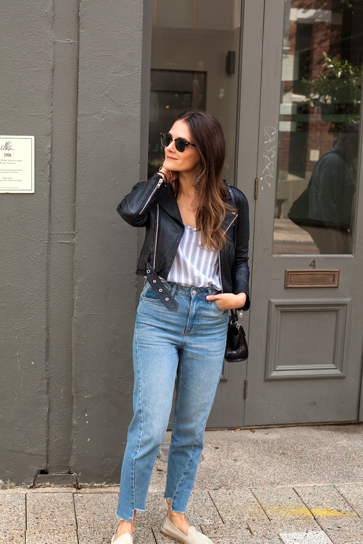 Biker jackets, By The Weekend striped blue camisole worn by Jenelle from fashion blog Inspiring Wit with black leather moto jacket, Manebi espadrilles and mom jeans