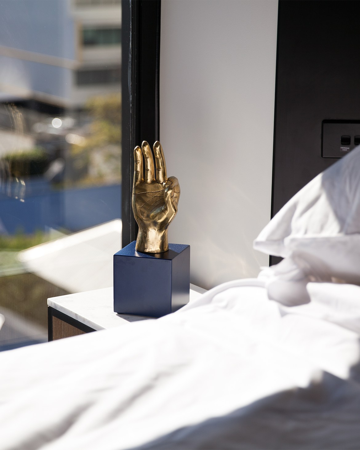 Tribe Hotel Perth brass sculpture, Jenelle from travel blog Inspiring Wit boutique hotel profile
