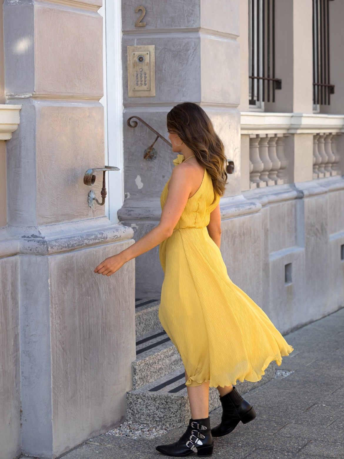 jenelle witty from fashion blog inspiring wit wearing mustard yellow dress called Skylines Dress from Keepsake the Label Valentine's Day 2018 edit with Toga Pulla boots