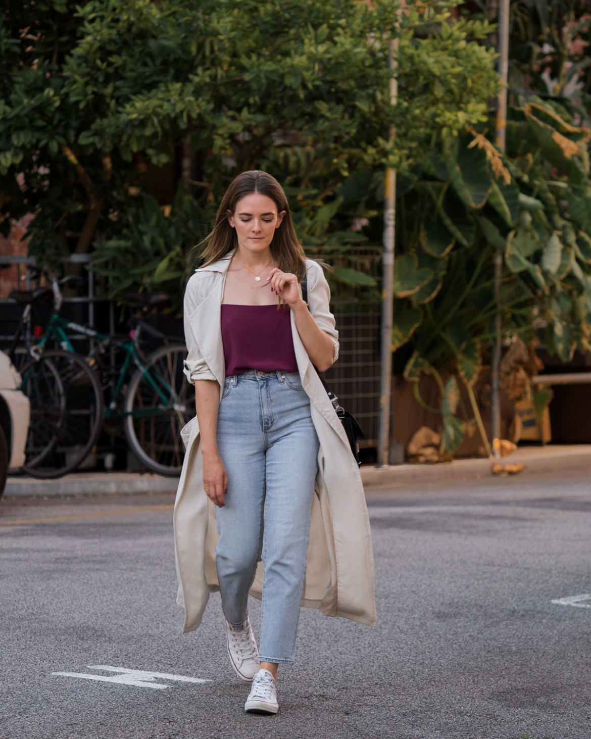Valentine's Day wearing Mom jeans, maroon top and trench coat outfit worn by Inspiring Wit fashion blogger Jenelle Witty