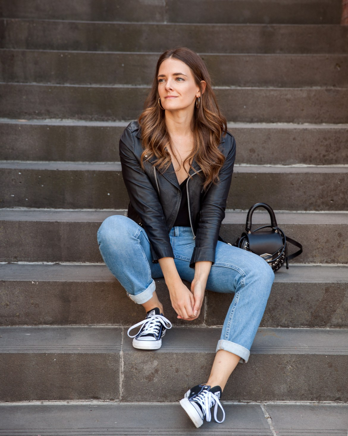 Everlane boyfriend jeans worn by Australian fashion blogger Jenelle from Inspiring Wit with leather jacket and Converse