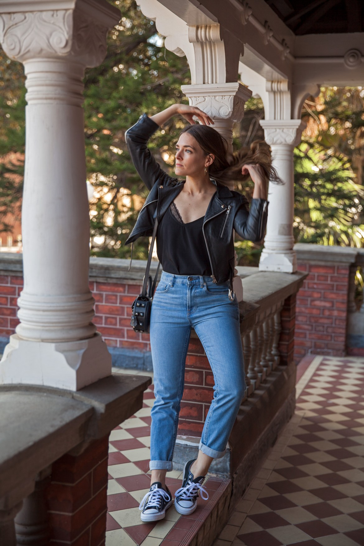 Everlane boyfriend jeans worn by Australian fashion blogger Jenelle from Inspiring Wit with leather jacket, Converse and lace long hair