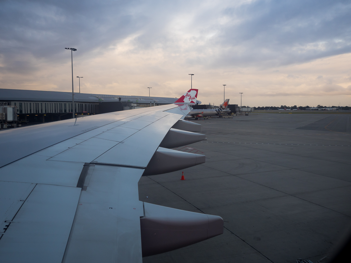 Plane wing AirAsia review flying from Perth to Penang with travel blogger Inspiring Wit