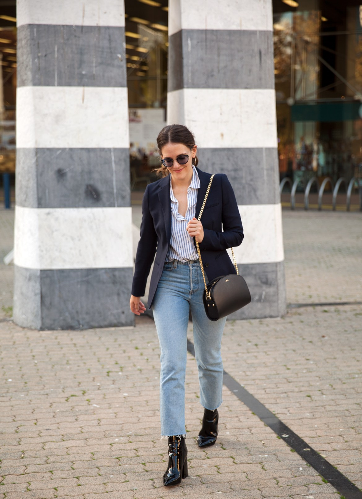 Essilor Transitions Colours Lenses worn with navy blazer, Levi's jeans, Alias Mae patent boots and A.P.C Luna Half Moon Bag by Inspiring Wit blogger Jenelle street style