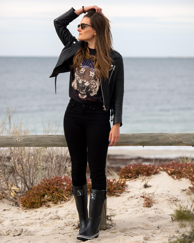 Winter outfit ideas black leather jacket, Anine Bing Tiger t-shirt, Mavi black skinny jeans, Evercreatures black gumboots worn by Inspiring Wit blogger Jenelle