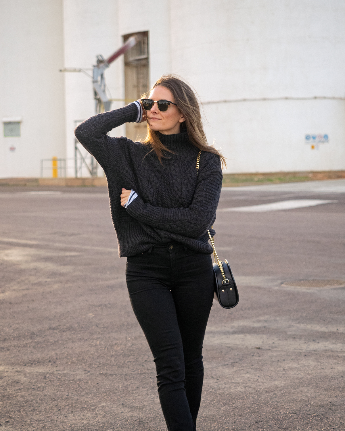 winter road trip style, Sassind black wool knit jumper, black Mavi skinny jeans, Dr Martens boots, APC half Moon bag, winter outfit worn by Jenelle Witty from style blog Inspiring Wit