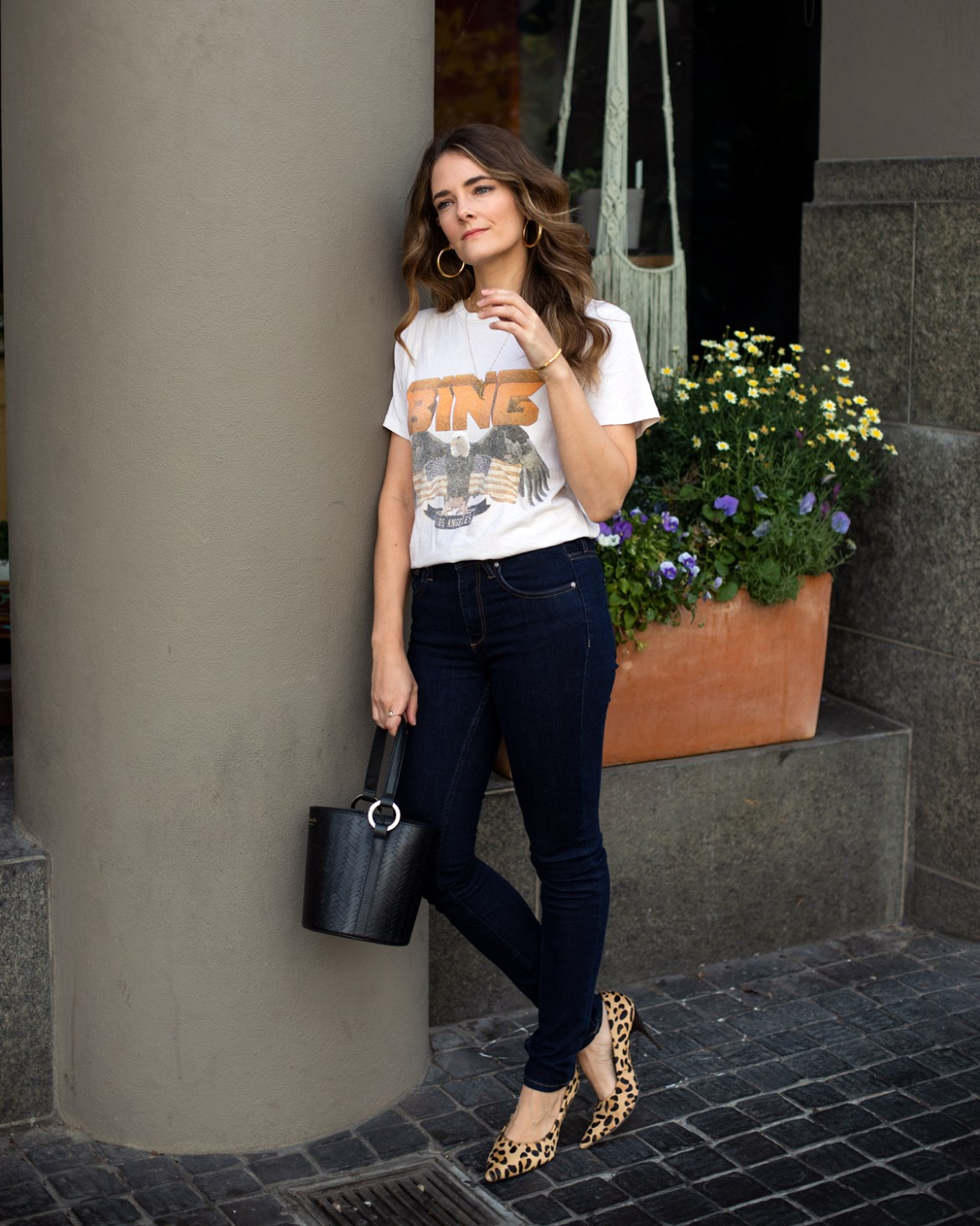 Anine Bing vintage tee outfit with Reiko skinny jeans and leopard print heels worn by fashion blogger Jenelle Witty from Inspiring Wit in a blog post about the 2019 big little goals